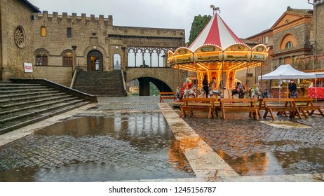 VITERBO, ITALY - NOVEMBER 25, 2018: Beautiful bright carousel in the main square of Viterbo at the Caffeina christmas village