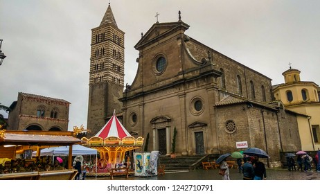 VITERBO, ITALY - NOVEMBER 29, 2018: Facade of beautiful Viterbo cathedral at christmas time in winter on rainy day