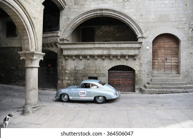 VITERBO (VT), ITALY - MAY 16: A light blue Porsche 356 1500 Super takes part to the 1000 Miglia classic car race on May 16, 2015 in Viterbo (VT). The car was built in 1952; a dog looks at.