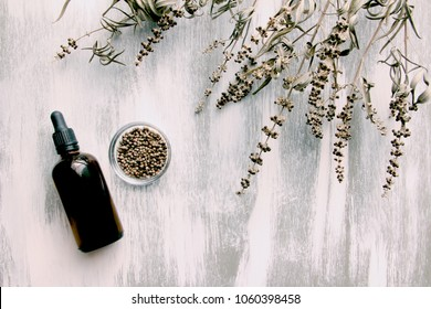 vitex agnus-castus dried flower and alcoholic tincture on white wooden background