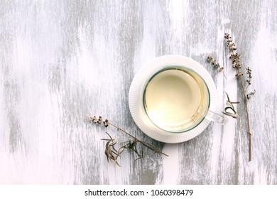 vitex agnus-castus dried flower and herb tea on white wooden background