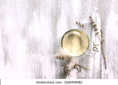 vitex agnus-castus dried flower and herb tea on white wooden background