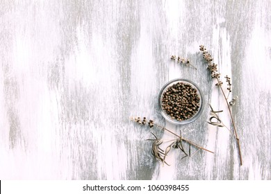 vitex agnus-castus dried flower on white wooden background
