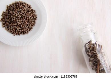 vitex agnus-castus dried herb on white wooden background