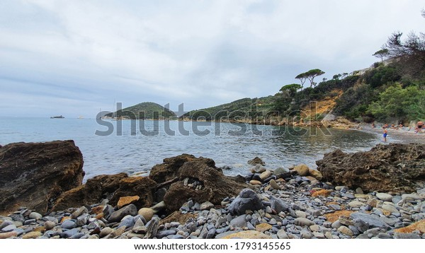 VITICCIO, ITALY August 03 2020: Viticcio beach with Capo d'Enfola in the background, Elba Island, Tuscany, Italy.