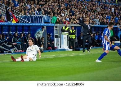 VITORIA, SPAIN - OCTOBER 06, 2018:Alvaro Odriozola (L), Ruben Duarte (R) and Julen Lopetegui (C) in action during the La Liga match between Deportivo Alaves and Real Madrid