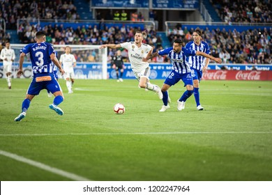 VITORIA, SPAIN - OCTOBER 06, 2018:Gareth Bale (C) competes fot the ball with Maripan (R) and Ruben Duarte (L) during the match between Deportivo Alaves and Real Madrid