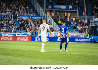 VITORIA, SPAIN - OCTOBER 06, 2018:Karim Benzema (L) and Ruben Duarte (R) in action during a Spanish League match between Alaves and Real Madrid