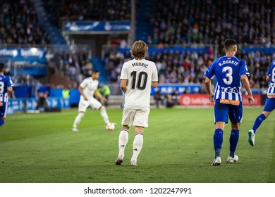 VITORIA, SPAIN - OCTOBER 06, 2018:Luka Modric (L) and Ruben Duarte (R) in action during the La Liga match between Deportivo Alaves and Real Madrid