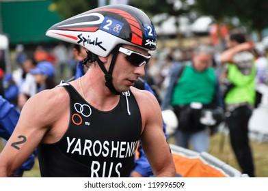 VITORIA-GASTEIZ, SPAIN - JULY 29: Nikolay Yaroshenko on transition zone in the Long Distance Triathlon World Championships, July 29, 2012 in Vitoria Gasteiz, Basque Country, Spain