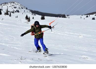 Vitosha, Bulgaria - February 03, 2019: Man riding snowkite on the plateau of Vitosha Mountain during the weekend