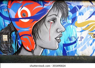 VITRY-SUR-SEINE, FRANCE -24 DEC 2015- Street art mural depicting a sad Marianne, the symbol of the French republic, crying with blood by Graffiti Ad Vitam Aeternam.