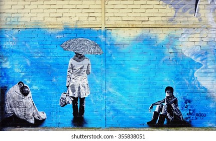 VITRY-SUR-SEINE, FRANCE -24 DEC 2015- Street art wall mural entitled Portraits by Canadian graffiti artist Indigo in Vitry.