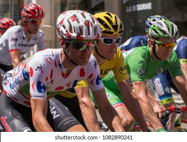 VITTEL, FRANCE - July 5, 2017: Start of stage 5 of  Tour de France 2017 in Vittel with Geraint Thomas (yellow jersey), Arnoud Demare (green jersey) and Nathan Brown (polka dot jersey) side by side.