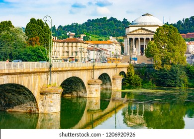 Vittorio Emanuele I bridge on Po river and Great Mother of God cathedral including the Memorial to the Fallen in World War I, Turin, Piedmont, Italy