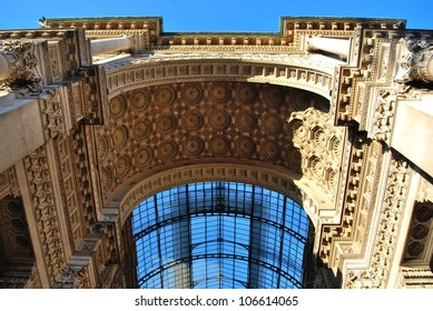 Vittorio Emanuele II Gallery, main entrance arch in Duomo cathedral square, Milan, Lombardy, Italy