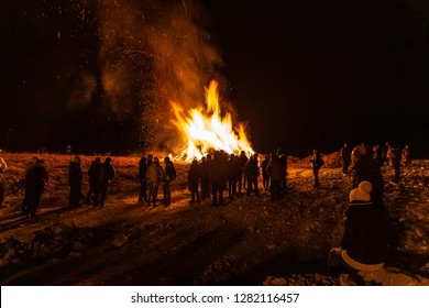 VITTORIO VENETO, ITALY - JANUARY 05 2019: People who attend the traditional bonfire of the epiphany