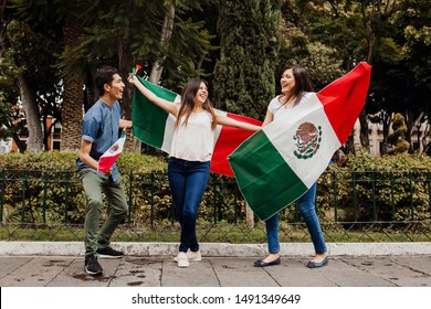 Viva Mexico, mexican guys with flag of Mexico in independence day in Mexico city