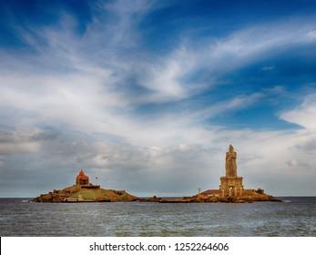 Vivekananda memorial rock and the 133-feet tall Thiruvalluvar statue in the Indian Ocean at Kanyakumari. View from the mainland. Hindu pilgrimage center.