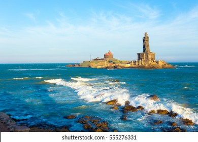 Vivekananda Rock is home to a memorial and neighboring island Thiruvalluvar Statue off the coast of Kanyakumari, Tamil Nadu, India on a blue sky day. Horizontal