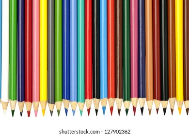 A vivid arrangement of brightly colored pencil crayons on a white background.
