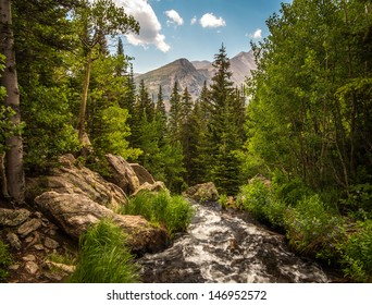 Vivid blue sky, mountains, and a flowing stream at Rocky Mountain National Park (RMNP), Colorado