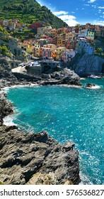 Vivid building by the ocean in Riomaggiore, Cinque Terre, Italy