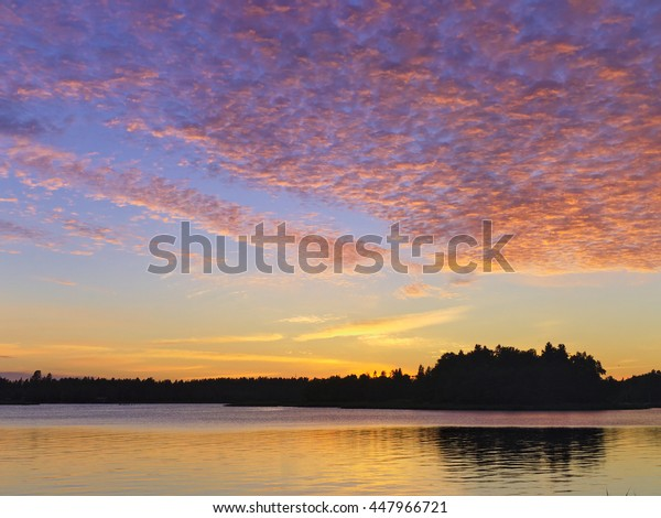 Vivid Clouds After Sunset Over An Island