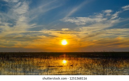 Vivid Color during Sunset over Lake Okeechobee in Florida, view from boat