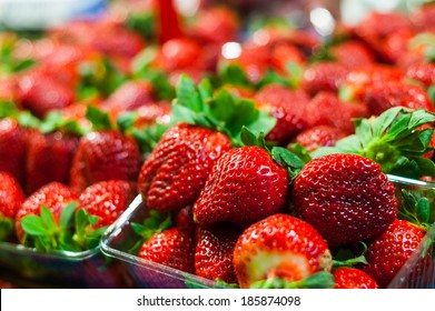 Vivid colorful red strawberries on the fruit market