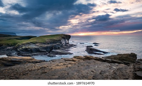 Vivid colour sky and green headland in Orkney