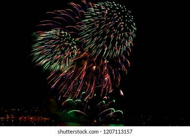 Vivid colours from Firework display, Plymouth harbour, UK, annual British Firework competition