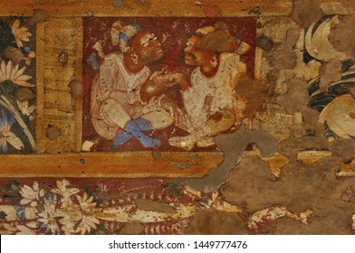 Vivid colours, mural wall-painting at Ajanta caves featuring two men possibly foreign traders, negotiating a transaction. The paintings in the Ajanta caves predominantly narrate the Jataka tales