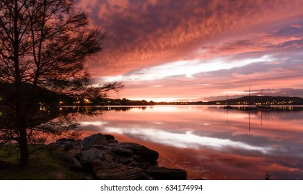 Vivid Dawn Sky in Pinks and Reflections over the Bay. Tascott & Koolewong, Central Coast, NSW, Australia