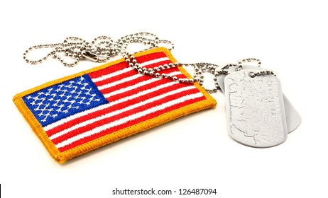 Vivid embroidered American Flag patch and vintage dog tags