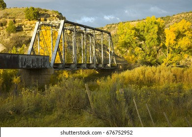 Vivid fall colors engulf this old railroad trestle in southwest Colorado.