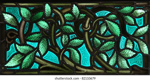 A vivid panel of lush leaves with twining stems in a stained glass window. From St. Paul's Church (1749), Halifax, Nova Scotia.