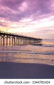 A vivid sunset creating a purple sky over the fishing pier at Carolina Beach, NC, USA