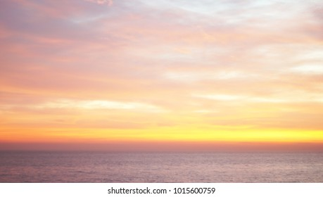 Vivid twilight sunset sky, wonderful sky after sunset over seacoast, natural background