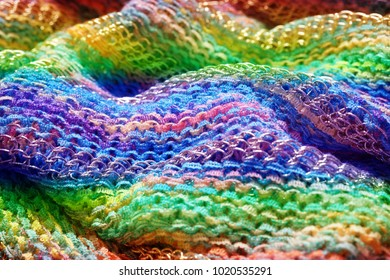 Vivid waves of gradient colorful fabric textured background.