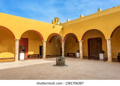 Vivid yellow colonnade under blue skies in Mexico