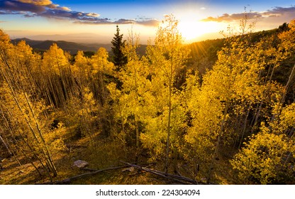Vivid yellow-golden sunset over the Santa Fe Ski Basin in Northern New Mexico