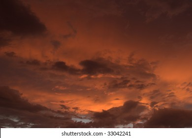 Vividly orange and red colored clouds