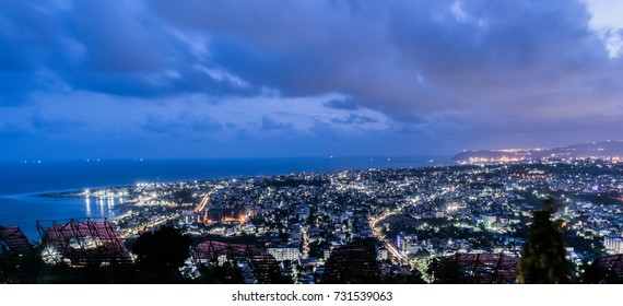 vizag city lights and the ramakrishna beach as viewed from the top of kailashgiri mountain.