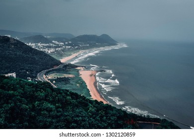 Vizag such a beautiful city with greenery all around. Mesmerizing beach road. Curved hills meeting blended sea. This shot was taken on 25 of September 2018 in Vizag, India.