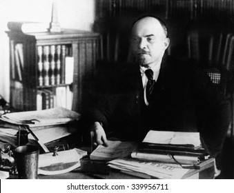 Vladimir Lenin, at his desk between 1920 to 1922. He was the head of the government of Revolutionary Russia from 1917 until his death in 1924.