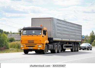 VLADIMIR REGION, RUSSIA - AUGUST 26, 2011: Modern yellow semi-trailer truck KamAZ 65116 at the interurban freeway.