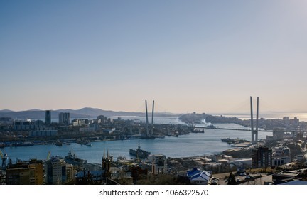 Vladivostok cityscape, sunset view. Color toned.