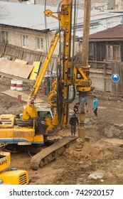 Vladivostok, Primorsky kray, Russia - February 28th, 2017: Vladivostok, building site with technics and builders.