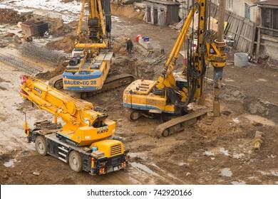 Vladivostok, Primorsky kray, Russia - February 28th, 2017: Vladivostok, building site with technics and builders.